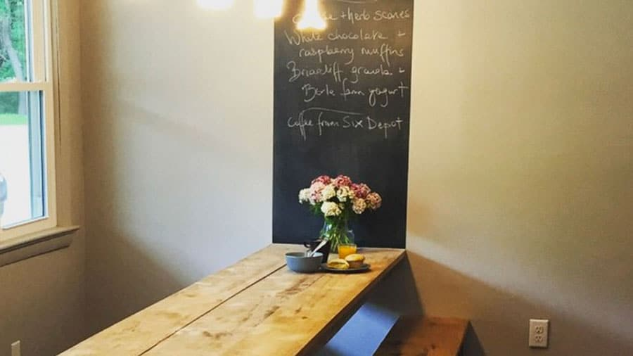Chalk board at the end of the table