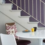 Dinner table with a stairway behind